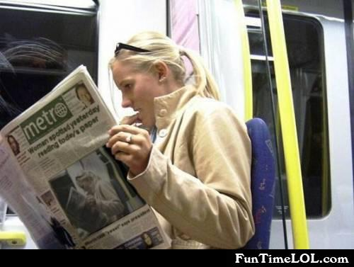 Women spotted yesterday reading today's paper
